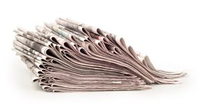 A pack of newspapers isolated. A pack of newspapers on a white background Stock Photography