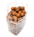 Pack of nuts. Opened pack of hazelnuts. Isolated on white background Royalty Free Stock Photo