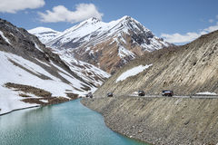 Pack of oil trucks in mountains stock images