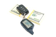 Pack of one hundred dollars banknotes and car keys. On white Stock Image