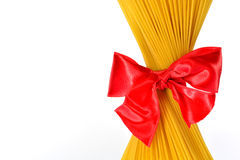 Pack of pasta associated red ribbon bow Royalty Free Stock Photo