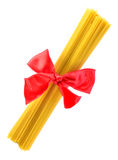 Pack of pasta associated red ribbon bow Royalty Free Stock Photography