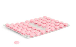 Pack of pink tablets Stock Photo