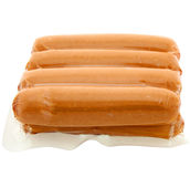 Pack of raw hot dogs on a white background Royalty Free Stock Images