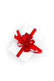 Pack With Red Bow On White Background Royalty Free Stock Image