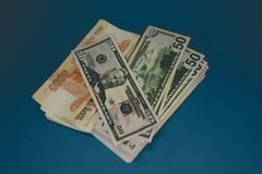 a pack of Russian rubles and dollars. two wads of money on a blue background. wealth of opportunity. success stock photo