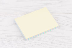 Pack of stickers note on wooden background. Pack of sticky stickers note on wooden white background Royalty Free Stock Photography