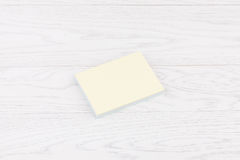 Pack of stickers note on wooden background. Pack of sticky stickers note on wooden white background Stock Photos