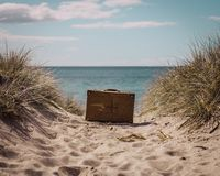Pack a suitcase and escape to the beach stock photography
