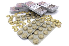 Pack of tablets with the coins Stock Photography