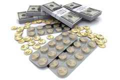 Pack of tablets with the coins in dollars Royalty Free Stock Images
