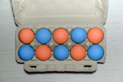 Pack of ten colorful eggs. Easter eggs. Painted eggs. A cardboard tray with raw chicken eggs, preparation for Easter stock photo