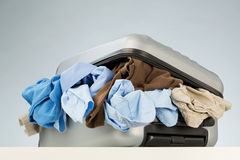 Pack for a Trip - Suitcase with Clothes Royalty Free Stock Image