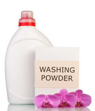 Pack of washing powder, liquid bottle and orchid flowers . Royalty Free Stock Photos