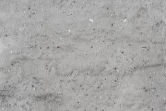 Packade väggar av övergiven byggnad, sedda spridda små stenar, texturer Arkivbild