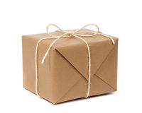 Package. Cardboard carton wrapped with brown paper and tied with string Royalty Free Stock Images