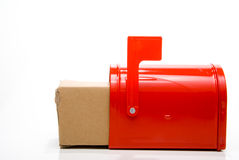 Parcel in red mailbox Stock Photos