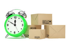 Package and alarm clock, delivery concept Stock Photo