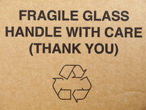 Package box fragile sign. Warning information with recycle sign on carton box Royalty Free Stock Photography