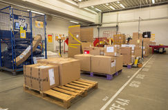 Package boxes for delivery in the DHL storehouse Royalty Free Stock Photo