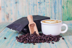 Package of coffee beans and hot latte art Stock Photos