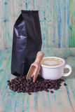 Package of coffee beans and hot latte art Stock Photo