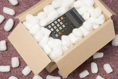 A Package Containing A Calculator. Business still life Stock Photos