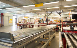 Package conveyor belt for distributing packages in DHL storehous Royalty Free Stock Photos