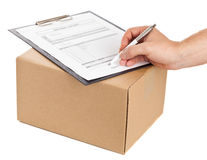 Package delivery. Man signing for delivery on package delivery form on clipboard for delivery on white background Stock Photo