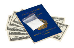 Package with drug over the Afghan passport Royalty Free Stock Photos