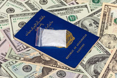 Package with drug over the Afghan passport Stock Images