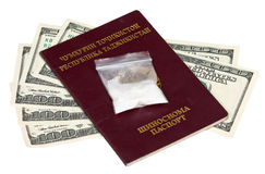 Package with drug over the Tajikistan passport Royalty Free Stock Photos
