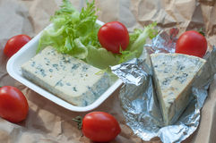 A package of food to take away including blue cheese, cherry tomatoes and fresh salad leaves Royalty Free Stock Photo