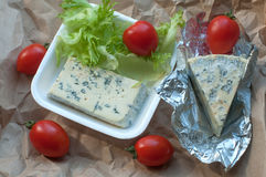 A package of food to take away including blue cheese, cherry tomatoes and fresh salad leaves Stock Photography