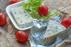 A package of food to take away including blue cheese, cherry tomatoes and fresh salad leaves Royalty Free Stock Image