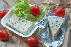 A package of food to take away including blue cheese, cherry tomatoes and fresh salad leaves Royalty Free Stock Photography