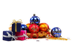 Package with gifts and Christmas ornaments. Royalty Free Stock Photography