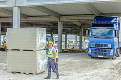 Package of glass wool for unfinished hall at building site, deli Stock Photo