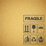 Package handling labels on cardboard Royalty Free Stock Images