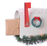 Package in Mailbox isolated. Package sticking out of and open mailbox decorated for christmas isolated on white. Square Composition stock image