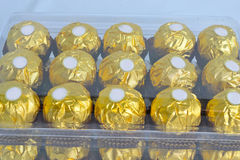 Package of many Golden Candy Stock Photography