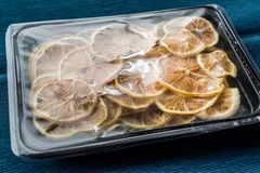Package Of Dried Lemon Slices / Dry And Sliced In Plastic Box / Container. Royalty Free Stock Photography