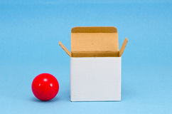 Package paper box and billiards ball Royalty Free Stock Photography