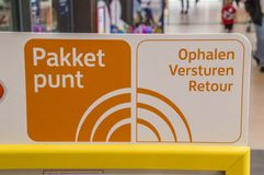 Package Pickup Point Sign From Post.nl At Diemen The Netherlands 2018. Package Pickup Point Sign From Post.nl At Diemen The Netherlands stock photography