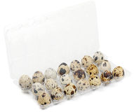 Package of quail eggs. On white Royalty Free Stock Photography