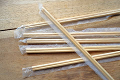 Package of readymade bamboo chopsticks on wooden background Stock Photos