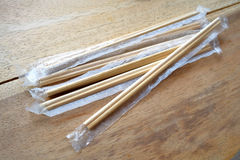 Package of readymade bamboo chopsticks on wooden background Stock Photo