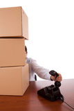Package service. A businessman with a pile of package parcels at the office Royalty Free Stock Photography