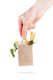 Package with a set of cheese in hand. Concept sale and delivery dairy products. Isolated Royalty Free Stock Photography