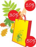 Package in a woman hand on the leafy background Stock Photos